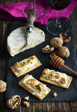 Blue Cheese and Walnut Crackers with honey. Stock Photography