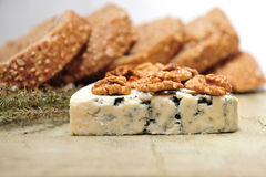 Blue cheese with walnuts Stock Images