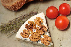 Blue cheese with walnuts and cherry tomatoes Stock Images
