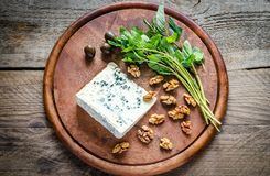 Blue cheese with walnuts and fresh mint Royalty Free Stock Photo