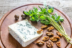 Blue cheese with walnuts and fresh mint Stock Photo