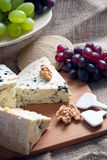 Blue cheese with walnuts and grapes Royalty Free Stock Photography