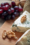 Blue cheese with walnuts and grapes Royalty Free Stock Image
