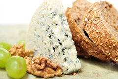 Blue cheese with walnuts and grapes Stock Photos