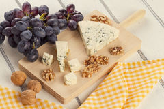Blue cheese, walnuts and grapes Stock Photo