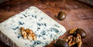 Blue cheese with walnuts Royalty Free Stock Images