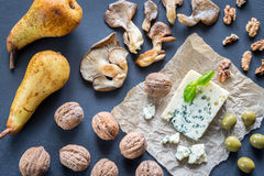 Blue cheese with walnuts, oyster mushrooms and green olives Stock Image