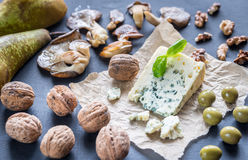 Blue cheese with walnuts, oyster mushrooms and green olives Royalty Free Stock Photo