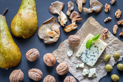 Blue cheese with walnuts, oyster mushrooms and green olives Stock Images