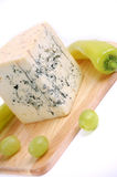 Blue cheese on the white background Royalty Free Stock Photos