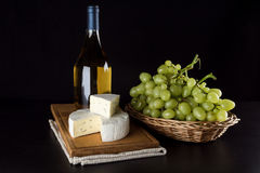 Blue cheese, wine bottle and grapes Royalty Free Stock Images