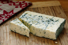 Blue cheese on wodden board Royalty Free Stock Image
