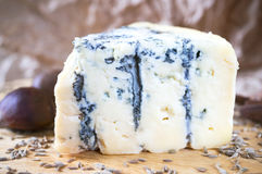 Blue cheese on wood board Stock Photos