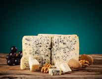 Blue cheese on wood stock photos