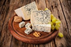 Blue cheese on wood stock image