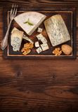 Blue cheese on wood stock photography