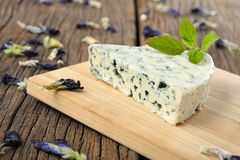 Blue cheese. On wooden chopping block royalty free stock photography