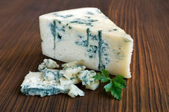 Blue cheese. On wooden table Royalty Free Stock Photo