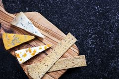 Blue cheeses on olive wood board Stock Image