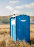 Blue chemical toilet Stock Images
