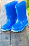 Blue child's wellington boots Stock Images