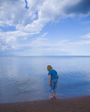 Blue Child, Sky, and Water Stock Image