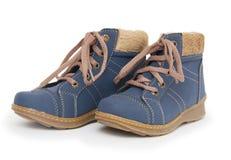 Blue children`s boots Stock Photos