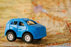 Blue children's car on map background Stock Photo