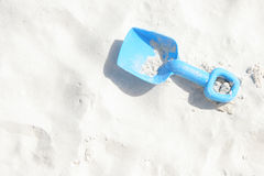 Blue childrens spade on the sandy beach, Aruba Royalty Free Stock Photo