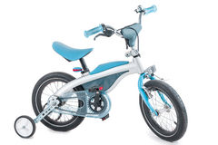 Blue childrens tricycle on a white background Royalty Free Stock Photography