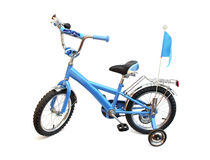 Blue childs bike on white. Blue childs bike with the klaxon on a helm and small wheels supporting isolated on a white background with clipping path royalty free stock image