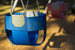 A blue childs swing Royalty Free Stock Photos