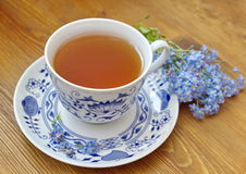 Blue china tea cup with forget me nots Royalty Free Stock Image