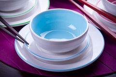 Blue Chinese bowls. Multicolored Chinese bowls with chopsticks Royalty Free Stock Image