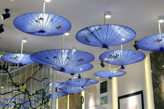 Blue chinese umbrella Stock Photos