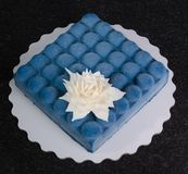 Blue chocolate velour cake with flower. A blue chocolate velour cake with flower Royalty Free Stock Image