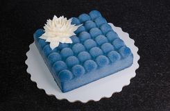 Blue chocolate velour cake with flower. A blue chocolate velour cake with flower Stock Photography