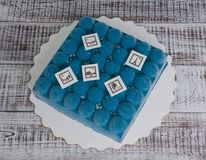 Blue chocolate velour cake with stamps. A blue chocolate velour cake with stamps Royalty Free Stock Photo