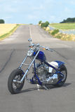 Blue chopper. Blue flame chopper motorcycle V twin Stock Image