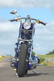 Blue chopper. Motorcycle front view Royalty Free Stock Photos