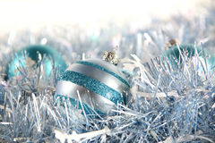Blue Christmas. Cool blue and silver ornaments nestled among some coordinating garland with space for copy royalty free stock images