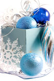 Blue Christmas. Blue and white christmas decorations in the blue box arranged in composition Royalty Free Stock Photography