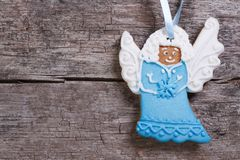 Blue Christmas angel on a background of wooden Stock Images