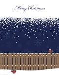 Blue christmas background. Blue snowflake background with banner, fence and robins Royalty Free Stock Image