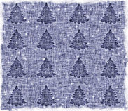 Blue, a Christmas background. Shabby, dirty canvas with Christmas trees Royalty Free Stock Images