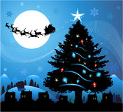 Blue christmas background. Christmas background with santa claus flying in the sky Stock Photo