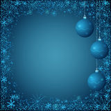 Blue christmas background. Dark blue  christmas background of hanging balls and anowflakes border Stock Images