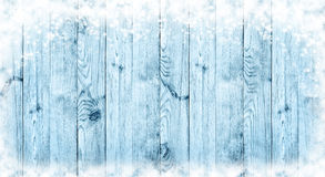 Blue Christmas background. Boards in the snow.Panorama. Blue boards and snow. Wooden Christmas background. Winter. New Year. Texture stock image