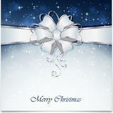 Blue Christmas background with bow Stock Photos