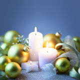 Blue Christmas background with candles , baubles and ribbons Royalty Free Stock Photography